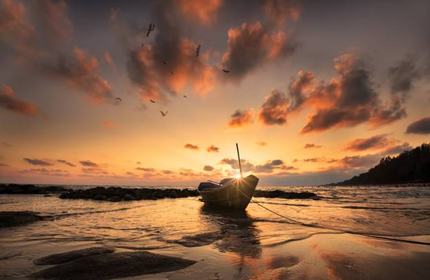 beached boat sunset background