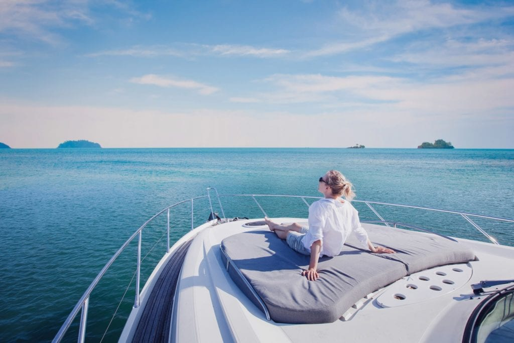 beautiful woman enjoying luxurious yacht cruise